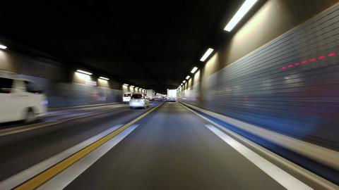 Twilight run from Shiodome in Tokyo over the Rainbow Bridge to Odaiba area Footage
