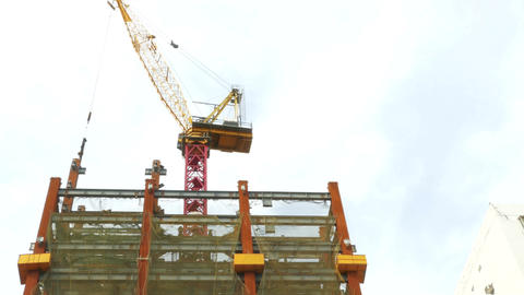 Tower crane on building moving I-beam Footage