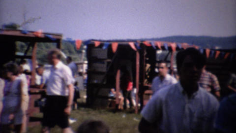 1961: Carnival fair amusement ride park crowds enjoying summer Footage