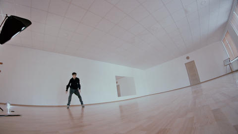 freestyle dancer practiced in the studio - dolly tracking camera Footage