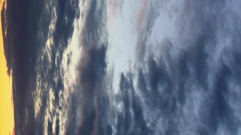 Vertical video. Cloud melts at sunset. Time Lapse Footage