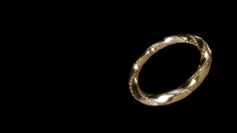 Gold ring on black able to loop Footage