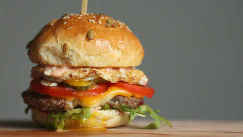 Great Burger with beef cutlet, tomatoes, mushrooms and cucumbers with melted Footage