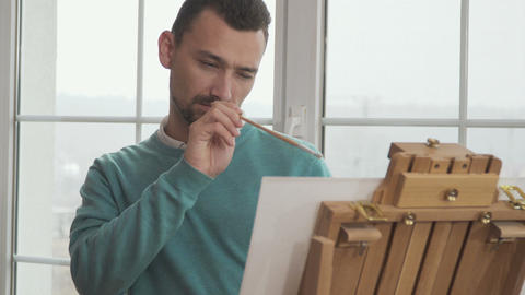 Handsome guy draws picture Footage