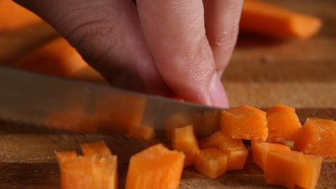 Cutting carrots into little squares Footage