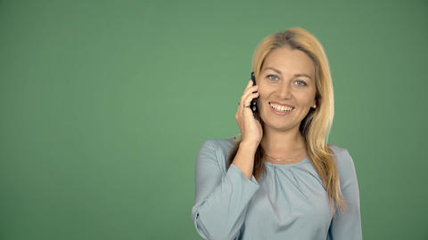 Attractive blonde businesswoman talking on mobile phone with client Footage
