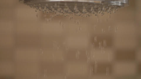 Shower flowing in close-up and slow motion Footage