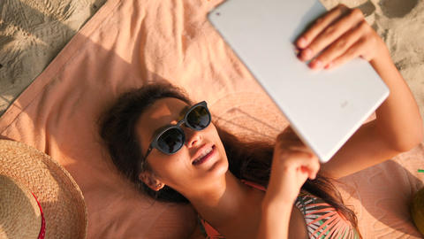 Young Smiling Mixed Race Tourist Girl Using Mobile Tablet Gadget on Tropical Live Action