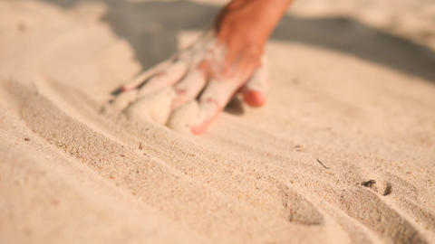 Female Hand Drawing Calm Lines on White Sand at Tropical Island Beach in Footage