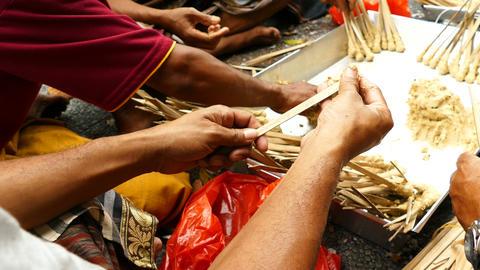 Balinese women hands make sacrificial food, Bali Footage