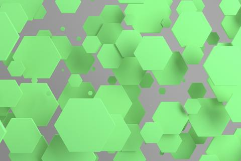 Green hexagons of random size on white background Photo