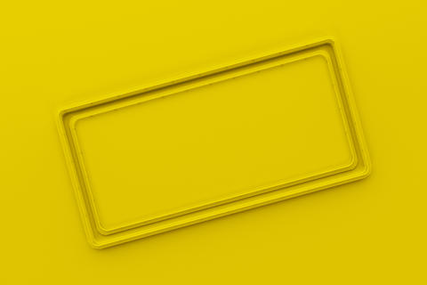 Rectangular colored plate with corners from tubes Photo
