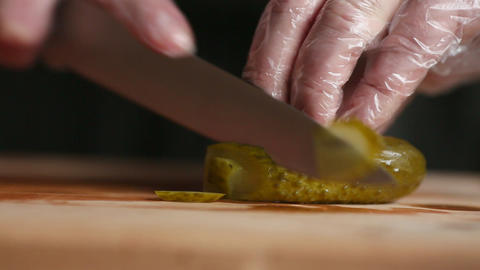a professional chef cuts a cucumber in gloves Footage