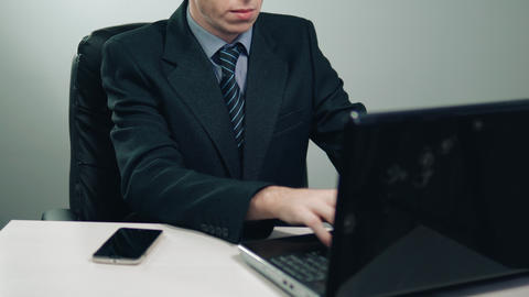 businessman uses laptop in office GIF
