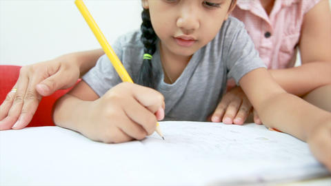 4K Mother teaching homework to Asian little girl at home Image