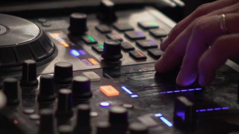 Dj mixes at the mixer at a music contest 89 Live Action