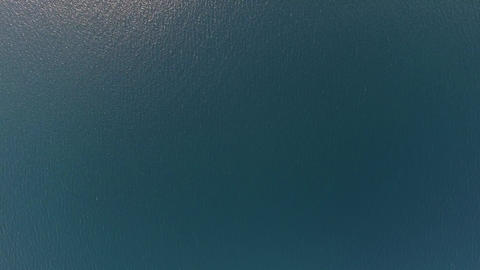 Flying over blue sea water surface, top view Footage