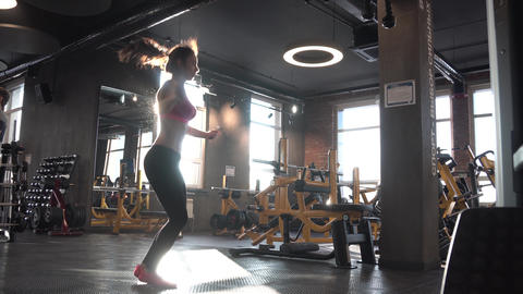 Skipping woman training at the gym working out. Fit young woman skipping rope Footage