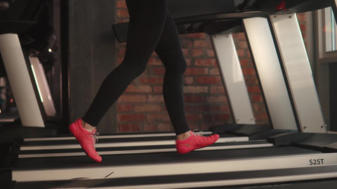 close-up legs of a girl running on treadmill. cardio in the gym Footage
