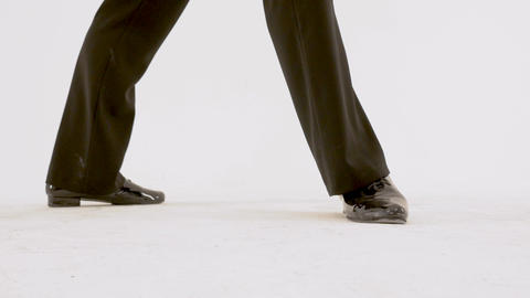 Legs of ballet men close-up, dancer in black suit performs retro dance on white Footage