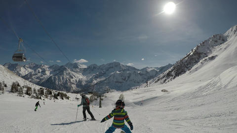 Little boy skiing in the Alps Footage