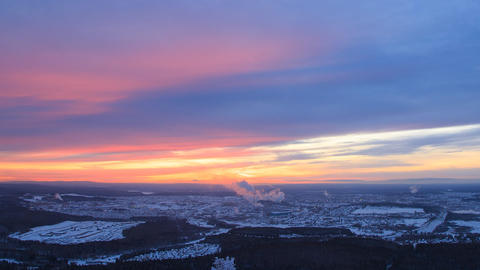 Sunset over the industrial city. The smoke from the chimneys. Revda, Footage