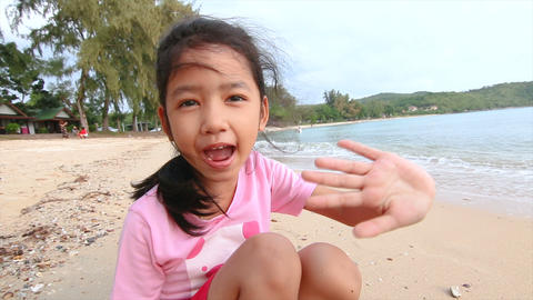 4K Asian little girl playing on the beach 003 Footage