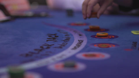 Gambler making bet by putting tokens Live Action