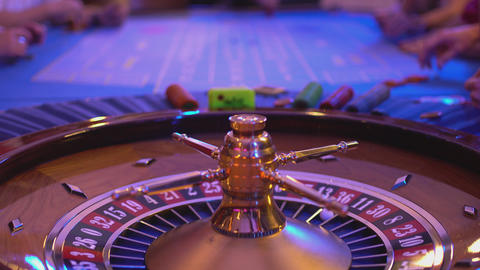 Roulette table in a casino - groupier pays out win Footage