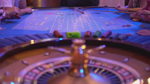 Roulette table in a casino - groupier collects lost chips from roulette table Live Action