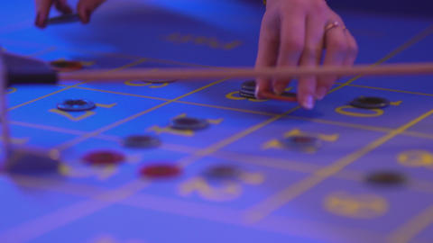 Roulette table in a casino - putting gaming chips on table Footage