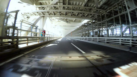 Driver's POV through the lower deck of a double decker bridge Footage