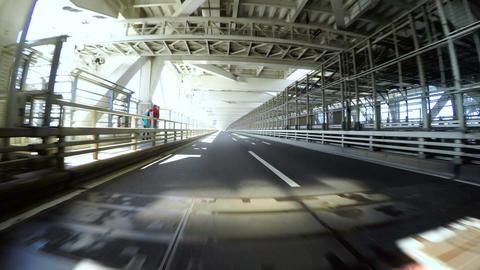Driver's POV through the lower deck of a double decker bridge ビデオ
