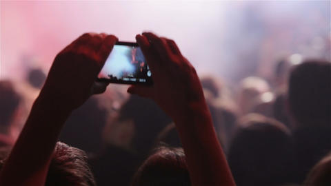 People taking photos or recording video with their smart phones at music concert Footage