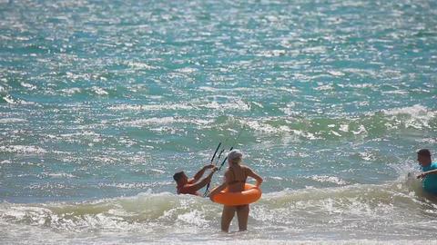 Kiteboarder surfing waves with kiteboard Footage