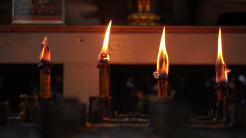 Candles burning in a temple. Abstract faith and belief in religion background Footage