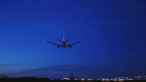 Night view of a modern jet landing at Narita International airport. With sound ビデオ