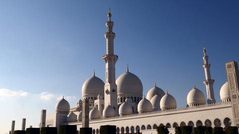 Beautiful Sheikh Zayed Grand Mosque Centre Abu Dhabi reflecting sunshine on a cl Footage