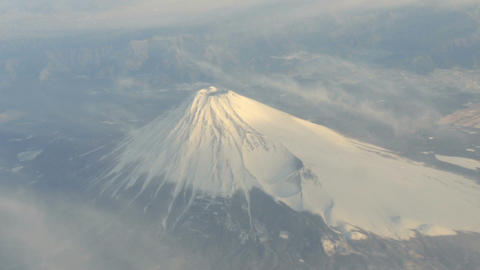 Aerial view of Mount Fuji covered in snow Footage