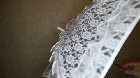 view of whirling wedding lace umbrella Live Action