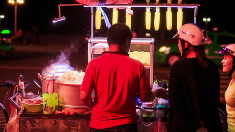 Backside Vietnamese Men Sell Street Fast Food at Night Footage