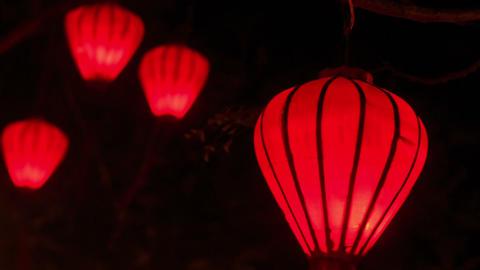 Closeup Red Chinese Lit Lanterns in Dark Night Sky Footage