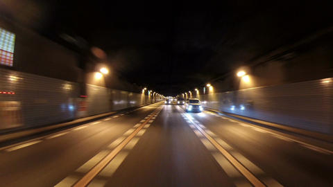 Rear view from a running SUV around the evening skies of Tokyo's suburban area Footage