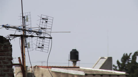 Zoom into a television antenna on the house roof Live Action