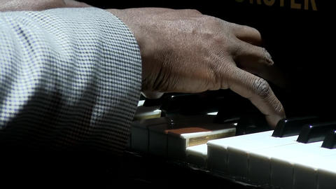 Afro american man hands playing piano Image