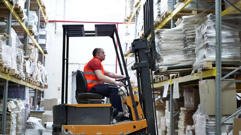 Warehouse worker driver moving forklift pallet Footage