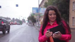 Business girl stops taxi in the city Footage