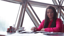 Young business woman working with office documents and answering a call Footage