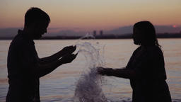 bright shine of water made by a playful couple Footage