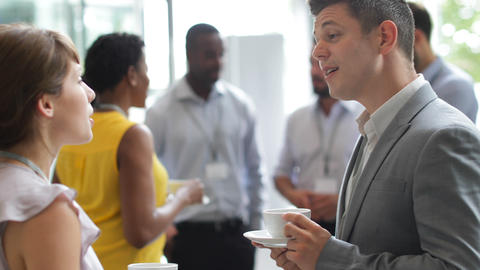 Business executives meeting at a networking event Live Action